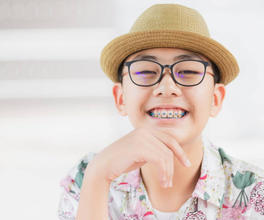 Young man or boy smile with teeth brace dental for healthy or medical background.
